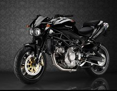 Moto Morini Corsaro 1200 Veloce. They just get better and better ... rather luvly all in black.