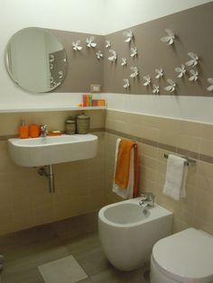bathroom idea (gray stripe with paper flowers . . . interesting)