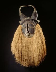 Africa | Mbawa ~ Face mask from the Suku people, Kwango, Bandundu, DR Congo | wood, raffia, pigment, vegetal fibre, textile | ca. prior to 1932 | It was not worn by young circumcised males but came out at various moments of the mukanda ceremony. Mbawa could drive away sorcerers and thieves. It was also the most effective mask for calling up or averting rain.