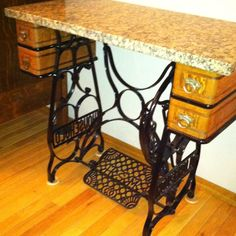 Create your own table add a piece of granite or wood to an old my mom collects old sewing machine bottoms just had a granite top made for her sciox Choice Image