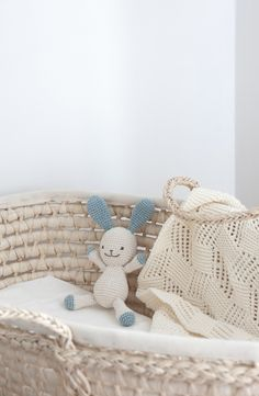 Nursery details. Crocheted bunny, knitted baby blanket