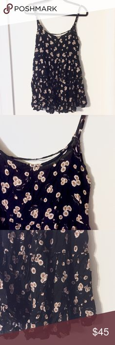 Brandy Melville Black Flower Print Dress Gently used Brandy Melville black with yellow flower print dress. Made in Italy. Material: 58% cotton and 42% viscose  CLOSET POLICY:  ✔️ACCEPT MOST OFFERS 📦BUNDLES (20% OFF 2 OR MORE) 🚫NO TRADES🚫 🚫NO PAYPAL🚫 Brandy Melville Dresses