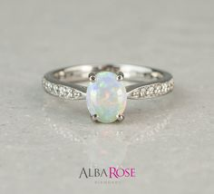 Alba Rose - Diamond and Opal engagement ring http://www.albarose.com/product/53871_53871