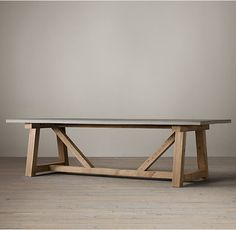RH's Salvaged Wood & Weathered Concrete Beam Rectangular Dining Table:Our table's smoothly honed thick concrete top with a softly weathered finish complements the natural beauty of solid salvaged pine timbers from 100-year old buildings in Great Britain.