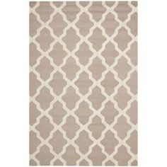 "Stylishly anchor your living room or master suite with this artfully crafted rug, showcasing a trellis motif for eye-catching appeal.  Product: RugConstruction Material: 100% WoolColor: Beige and ivoryFeatures:  Hand-tuftedMade in IndiaPile Height: 0.63"" Note: Please be aware that actual colors may vary from those shown on your screen. Accent rugs may also not show the entire pattern that the corresponding area rugs have.Cleaning and Care: Professional cleaning recommended"