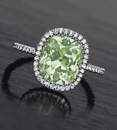 2.49-carat, old-mine cut fancy yellowish green diamond ring by JAR • Christie's