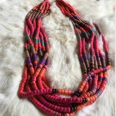 """MULTI- COLOR BEADED NECKLACE GIFT Beautiful!! Wooden beads close off the two ends however, the beads seem plastic. Vibrant colors from Pink and Orange to Brown and Black. Hook closure. 24"""" open. -No trades. None Jewelry Necklaces"""
