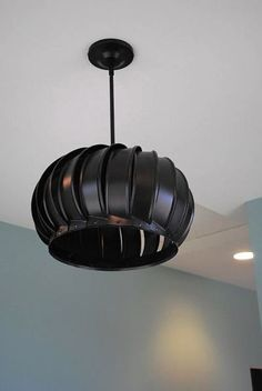 Paint a discarded wind turbine to create a light fixture with flair.