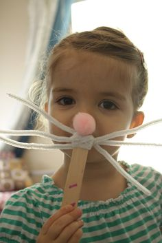 """Easter bunny """"mask"""" craft for children made with fuzzy pipe cleaners and a pompon on a craft stick! CUTE!"""
