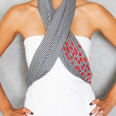 The Peyton - Navy & White Stripes w/ Poppy.  http://www.terracottanewyork.com/collections/scarves/products/the-peyton-navy-white-stripes-w-poppy-trim.  Also remember to LIKE us on facebook at www.facebook.com/terracottanewyork.