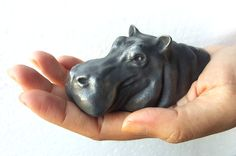 This is Bronze/Iron cast using cold cast method Sculpture of Hippopotamus Figurines Hand made sculpted in Clay and cast in Bronze or Iron. Very hi detail and a must have collectable, looks great on any table or shelf. Special Pricing only for short time. 1.5 in x 2 in x3.9 in (height x width x depth) Wt .35 Kg with packing For just $8 you can personalize the base of this sculpture. Please purchase the sculpture first and then purchase this listing. Convo the text to me. Note … more the…