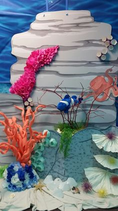 Coral reef scene of cardboard, paper, and pool noodles at BHCOC  Submerged VBS.