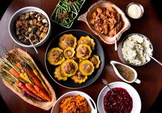 Vegetarian Thanksgiving meal menu: Quinoa stuffed acorn squash rings, whipped sweet potatos, rosemary roasted carrots, green beans and caramelized shallots, wild mushroom gravy, french bread stuffing with swiss chard and caramelized red onions, ginger orange cranberry sauce and slow cooker pumpkin bread pudding with crème anglaise