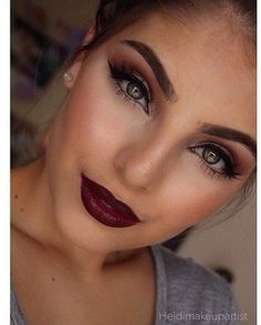 Bold brows, dark red lip, and thick eyeliner to make the perfect going out look.