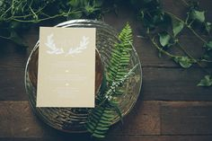 Organic invitations by @pinkpiggydesign. White ink printed on kraft stock