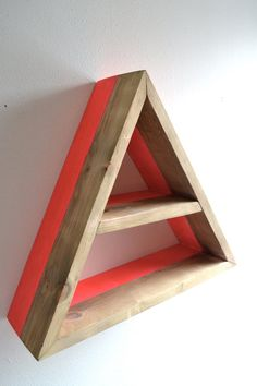 Triangle Shelf with Neon Pink Accent on Etsy, $25.00 (love this, cute idea to put up pictures and succulent plants!)