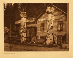 "Carved posts at Alert Bay, 1914. Curtis Caption: ""These two heraldic columns at the Nimkish village Yilis, on Cormorant island represent the owner's paternal crest, an eagle, and his maternal crest, a grizzly-bear crushing the head of a rival chief."""
