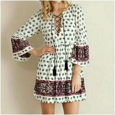 $38 TODAY ONLYNEW BOHO LACE UP DRESS New Ivory Printed Baby Doll Dress featuring bell sleeves and lace up front ties with tassel. Fully lined.  Available in S,M,L 100%Rayon (Lining 100% Polyester) 4 Bidden Boutique Dresses Mini