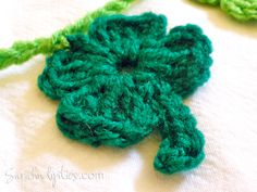 Four-Leaf Clover:Ch 5, join with a sl st to 1st ch to form a loop. Rnd 1: {ch 3, 1 trc, 1 dc, 1 trc, ch 3, slip stitch into loop} repeat 4 times total. Stem: Ch 5, hdc in 2nd ch from hook, sc in rem ch sts. Fasten off and weave in ends.