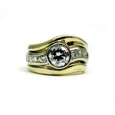 Sculptural custom made diamond engagement ring in 14k yellow gold and 14k white gold.
