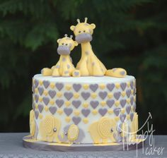 "Elephants and giraffes - Yellow and gray scheme elephant and giraffe baby shower. 8"" coconut cake filled with coconut buttercream."