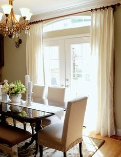 Neutral dining room. love the white curtains that go all the way to the ceiling