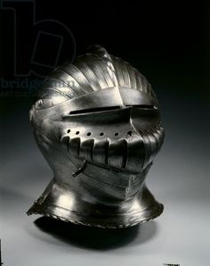 Close helmet in Maximilian style, c.1510-30 (steel with brass rivets) Distinguished by its regularly fluted surfaces, armor in this style was popularized in South Germany during the early 1500s. The style is usually called 'Maximilian', as it was introduced during the reign of Emperor Maximilian I (1493-1519). The style reflects male costume of the period and the shift to the new rounded forms of the Renaissance.