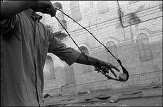 Larry Towell, Protester loading sling, Bethlehem, West Bank, 2000