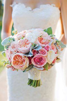 Bouquet of roses, dusty miller and ranunculus by Blush Botanicals.