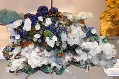 """Carbonite Minerals : Calcite (White) Azurite(Blue) with Malachite (Darker Green)and Olivenite(Green). approx. 5"""" across. A great specimen from the Ancient mines at Lavrion in Greece.  Calcite on Azurite with Malachite and Olivenite. Specimen measures approx. 5"""" across. Hilarion Mines, Kamariza, Lavrion District, Attikí Prefecture, Greece."""