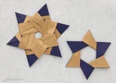 Two different designs of modular origami stars by Maria Sinayskaya. Each folded from 6 square sheets of double-sided kraft paper without glue.