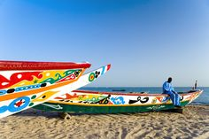Colorsful traditional fisheermen's boats on a beach in Dakar.