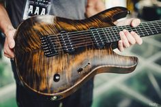 "Mayones Guitars Basses has built a custom Setius baritone 7-string for Mark Holcomb - Roasted mahogany body & mahogany/maple 5-piece neck, flamed maple top in Antique Black Oil finish, Mark's DiMarzio protoype pickup set, Hipshot hardware, 27"" inch scale — Photo by Nolly #periphery #mayones"