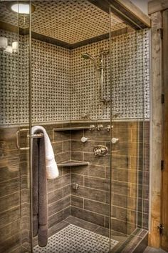 like the tile pattern - with a trim area around the bottom of the shower floor, smaller tile in the center and arond top of shower: