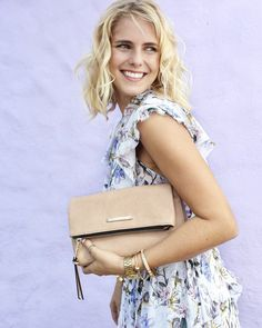 Get this amazing style: www.poppyandpeonies.com/jenna  The Foldover, wear this bag 4 different ways! (Clutch, crossbody, wristlet and shoulder straps included!) Vegan leather. ~$89~  For more info & features, please contact: jenna@poppyandpeonies.com