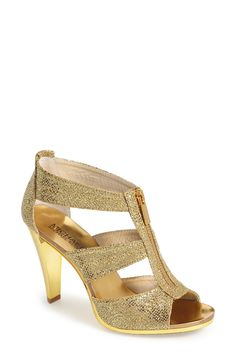 These shiny gold Michael Kors sandals will add a touch of glam to a jeans & cute tee combo.