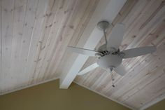 Pickled wood ceiling. Would look really good with exposed wood beams.
