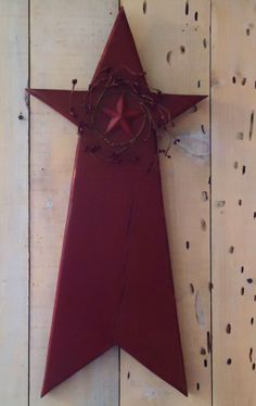 Medium Primitive Wood Star with Red Berry Wreath.