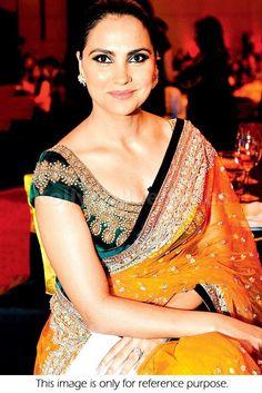 Bollywood Actress Lara Dutta Net Saree in Orange and Green color