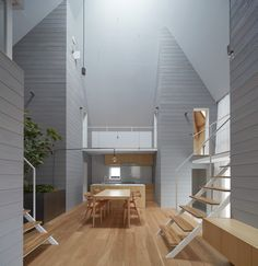 House in Iwakura, a minimal home in Japan creates a loft-like feeling in this 2-story home with open spaces, open circulation via stairs and bridges, and lots of natural daylight. By Airhouse.