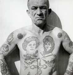 Decoding Russian criminal tattoos – in pictures | Art and design | The Guardian  The rose on this man's chest means he turned 18 in prison. The 'SOS' on his right forearm either stands for 'Spasite Ot Syda' (Save me from judgment); 'Spasayus Ot Sifilisa' (Saved from syphilis); or 'Suki Otnyali Svobodu' (Bitches robbed my freedom).
