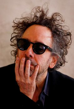 Director Tim Burton attends a press conference prior to a press preview of his exhibition 'The World of Tim Burton' on March 27, 2014 in Prague, Czech Republic. The exhibition, which runs until August 3, will feature 500 of Burton's drawings, paintings, photographs, sketchbooks, moving-image works, and sculptural installations.