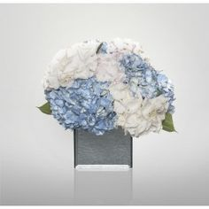 A beautiful hydrangea mix arrangement presented in a mirrored cube vase