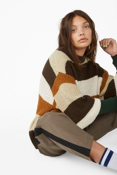 fcc2ee67d3 A striped knit sweater in earthy brown tones and shades. This one comes in a  crewneck and a longing for sweater weather. In a size S the chest width is  116 ...