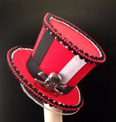 Hey, I found this really awesome Etsy listing at https://www.etsy.com/listing/194838383/harley-quinn-inspired-mini-top-hat