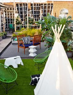 Eclectic Decor - A rooftop patio with a dining area, seating area, and kids play area with a tepee Rooftop Design, Balcony Design, Garden Design, House Design, Pergola Plans, Pergola Kits, House In The Clouds, Rooftop Patio, Rooftop Decor