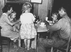 miner and his family eating dinner - Kentucky Straight Creek Coal Co. Four Mile, Bell County 1945