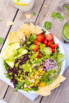 Summer Taco Salad Bowls.  No oven required for this quick, easy and delicious taco salad!  The perfect way to use those fresh summer vegetables!  All topped with a bright flavorful herb dressing!