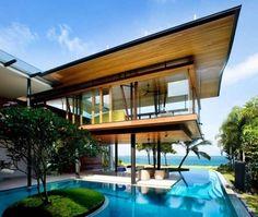 Modern tropical bungalow design by Guz Architects