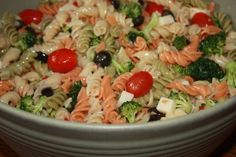 Cook tri colored rotini.  Let it cool and mix in:  1 can black olives (sliced or whole)  Grape tomatos  Cut up squares of mozzerella  Pepperoni  Broccoli  And cover it all in zesty Italian dressing and let it mix and soak in the refrigerator for about an hour before serving. It's a great side or a meal.